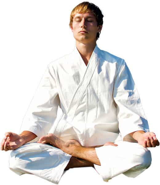 Martial Arts Lessons for Adults in Manahawkin NJ - Young Man Thinking and Meditating in White