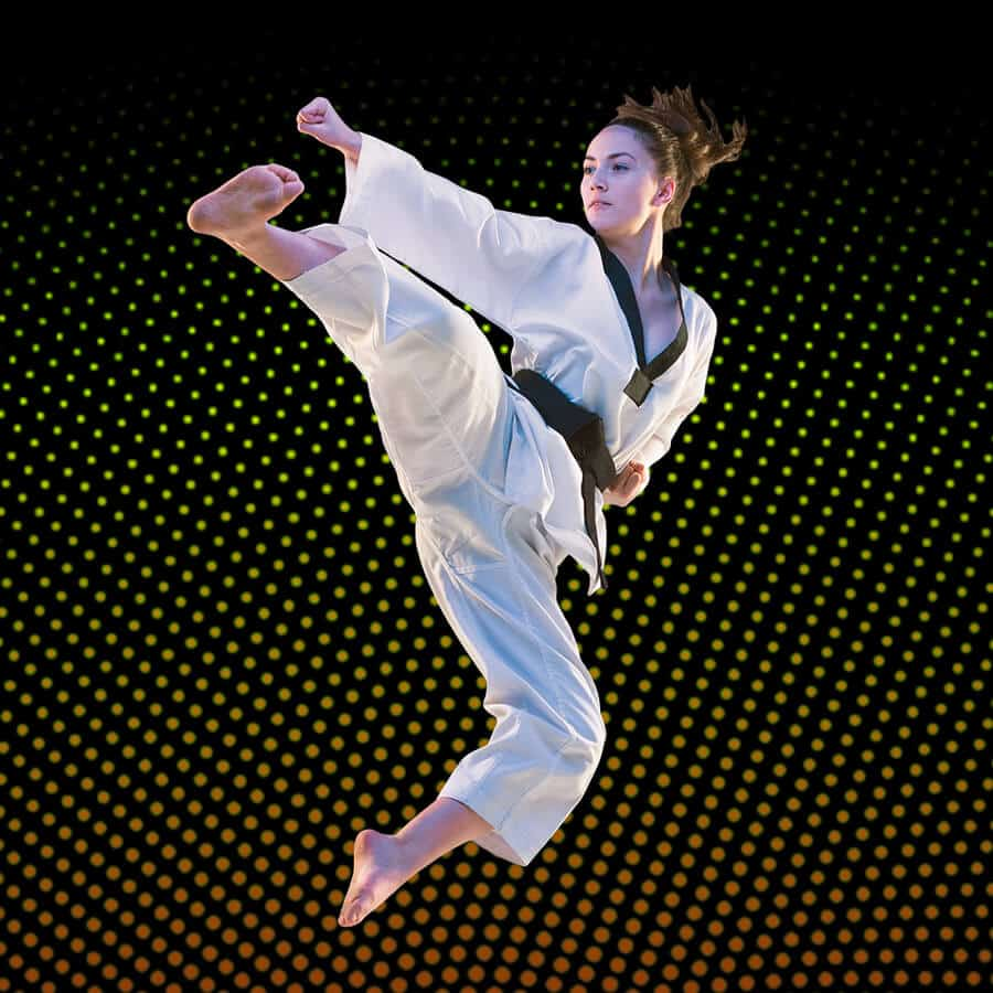 Martial Arts Lessons for Adults in Manahawkin NJ - Girl Black Belt Jumping High Kick