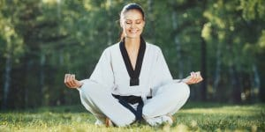 Martial Arts Lessons for Adults in Manahawkin NJ - Happy Woman Meditated Sitting Background